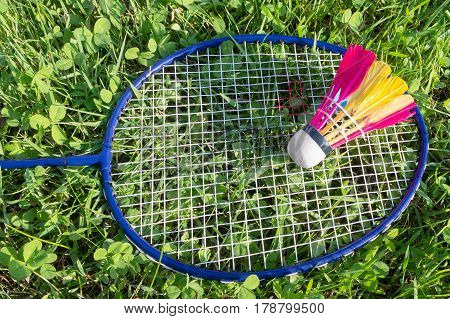 Badminton Racket And Shuttlecock On Grass