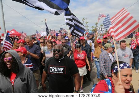 Huntington Beach, CA - March 25 2017: Make America Great Again March. Thousands of Supporters of republican president Donald Trump, wave flags, signs and march at a MAGA March in Huntington Beach.