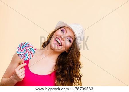 Woman Holds Colorful Lollipop Candy In Hand