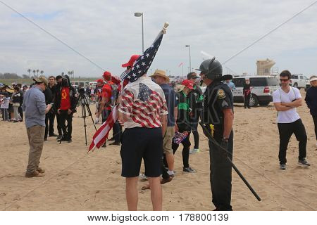 Huntington Beach, CA - March 25 2017: Make America Great Again March. Protesters of republican president Donald Trump, try to fight supporters and police at a MAGA March in Huntington Beach.
