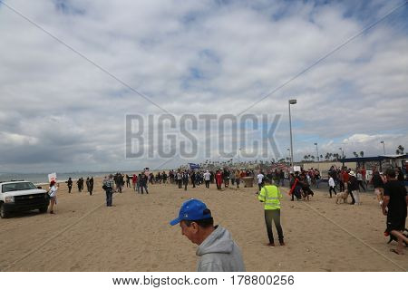 Huntington Beach, CA - March 25 2017: Make America Great Again March. Protesters of republican president Donald Trump, try to disrupt a Parade  at a MAGA March in Huntington Beach.