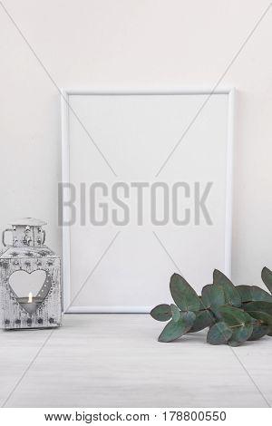 Frame mockup vintage candle holder branches of green eucalyptus on white background styled branding social media