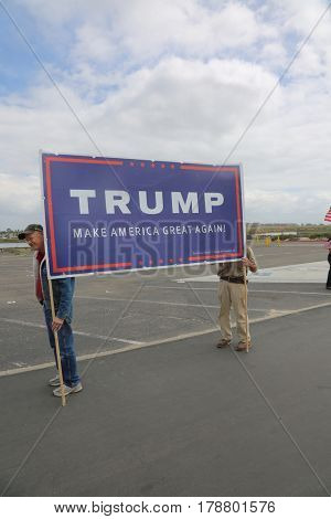 Huntington Beach, CA - March 25 2017: Make America Great Again March. Thousand of Supporters of republican president Donald Trump, wear T-Shirts march and wave flags, at a MAGA March.