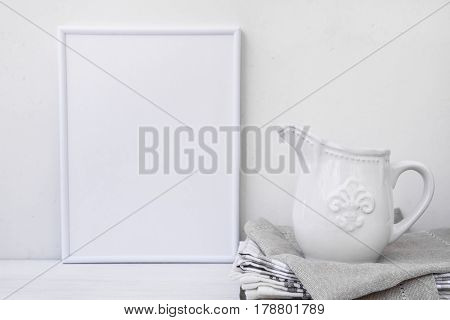 Frame mockup white vintage pitcher on stack of linen towels minimalist clean styled image branding marketing copyspace