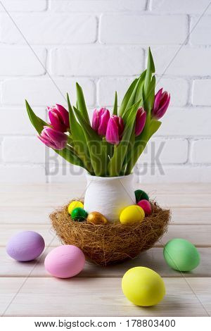 Easter Table Centerpiece With  Nest And Pink Tulips In Flower Pot