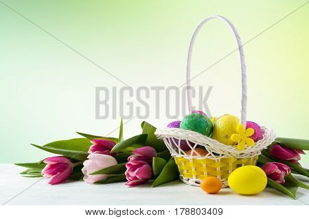 Happy Easter Elegant Background With Painted Eggs In Yellow Basket