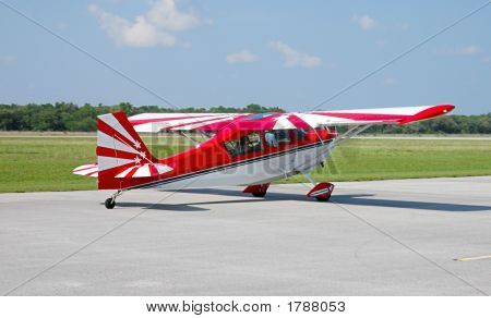 Red And White Plane Taxying