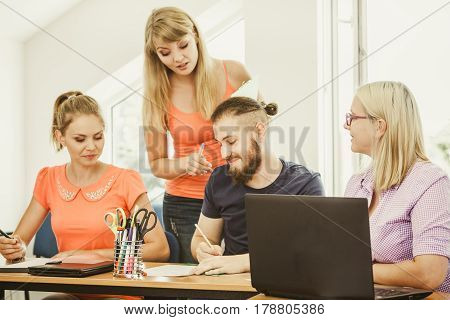 Students And Teacher Tutor In Classroom