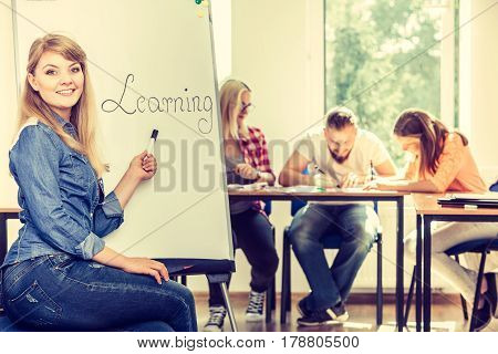 Student Girl Writting Learning Word On Whiteboard