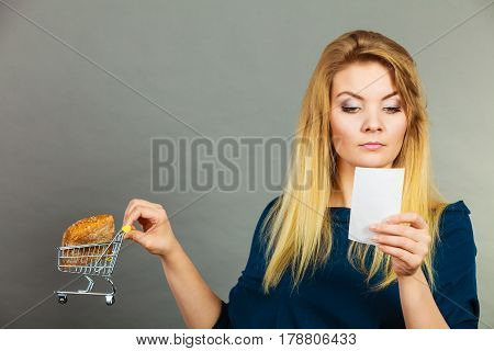 Woman Holding Shopping Basket With Bread
