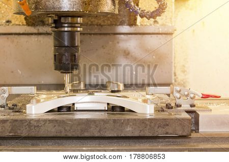 The CNC milling machine cutting the sample part with the ball endmill
