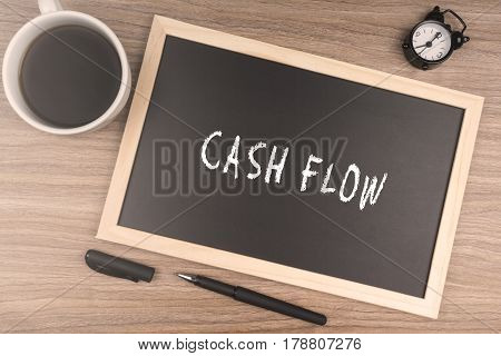 CASH FLOW words on chalkboard. Business concept.