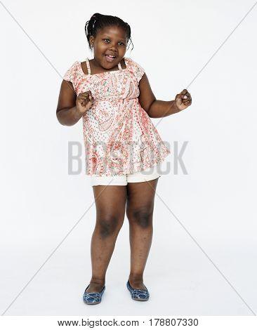 African little girl smiling casual studio portrait