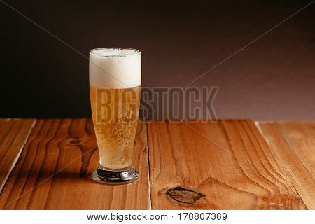 Glass of beer on the wood table