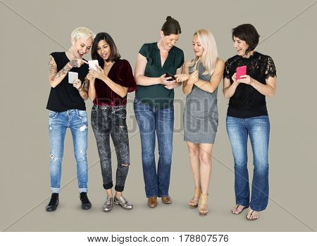 Happiness group of girlfriends smiling and connected by mobile phone