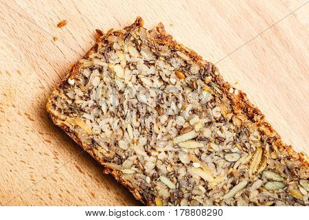 Healthy food fit diet products concept. Whole grain bread with many big grains
