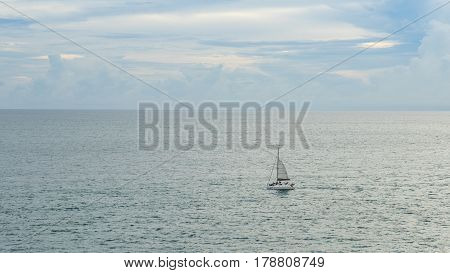 Lonly Yacht Sailing in the Sea at Sunset
