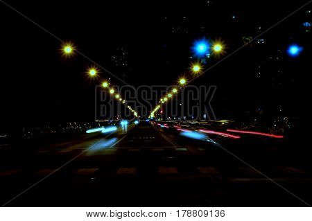 streaks of car lights at night in street scene