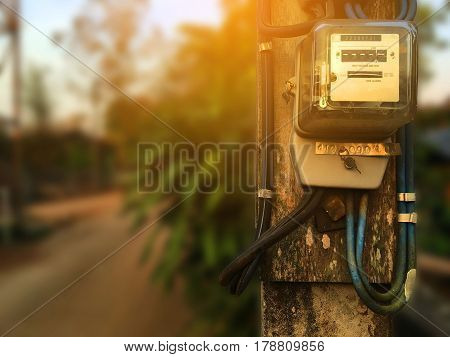 Electric meter at power poles. in countryside