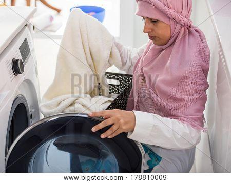 Muslim Arabian woman in new modern home