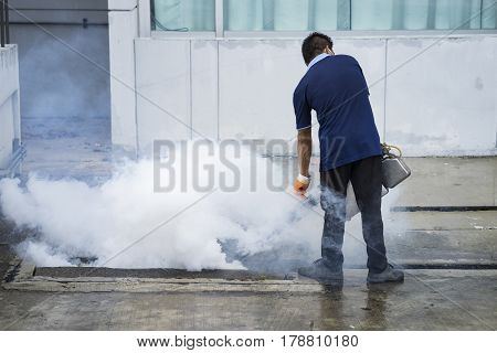 The man fogging to eliminate mosquito, close up