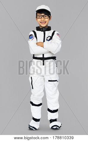 Young Boy in Astronaut Costume Studio Portrait
