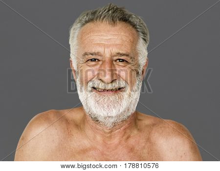 Senior adult man mustache smiling bare chest studio portrait