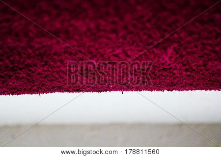 Red towel texture whit white background ant view