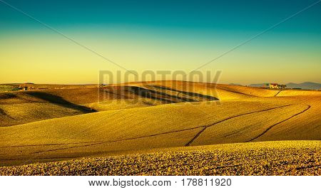 Tuscany countryside panorama rolling hills and plowed fields on sunset. Pisa Italy Europe