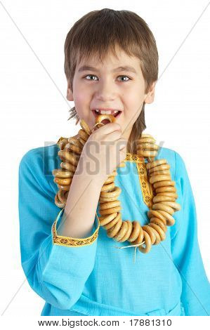 The Boy Eating A Bread Ring