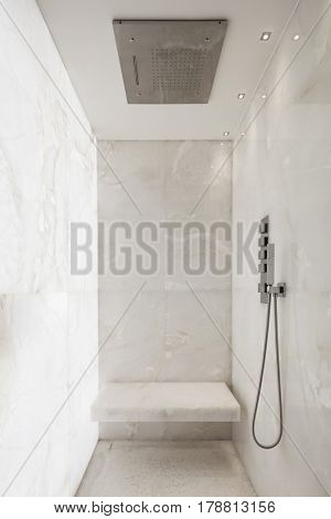 Shower covered in white marble