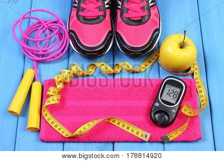 Glucometer, Sport Shoes, Fresh Apple And Accessories For Fitness On Blue Boards, Copy Space For Text