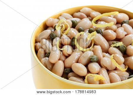 White cannellini beans with capers and lemon zest.
