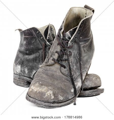 Pair of old work boots, isolated on white.