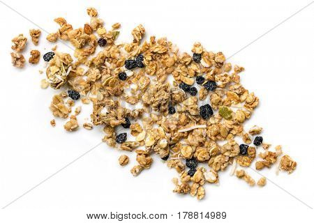 Crunchy granola or muesli scattered, isolated on white, top view.