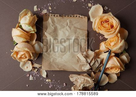 Blank craft paper with flowers around, copy space