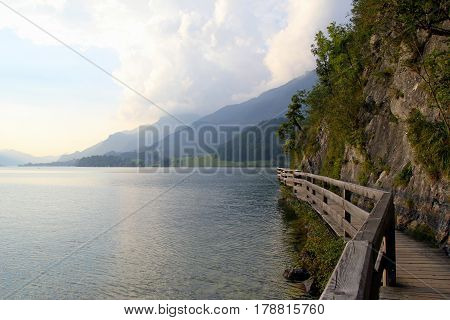 Travel To Sankt-wolfgang, Austria. The Road Near To Lake With The Mountains On The Background In The