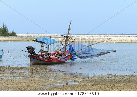 Fishing boat on the shore in Khao Lak, Thailand