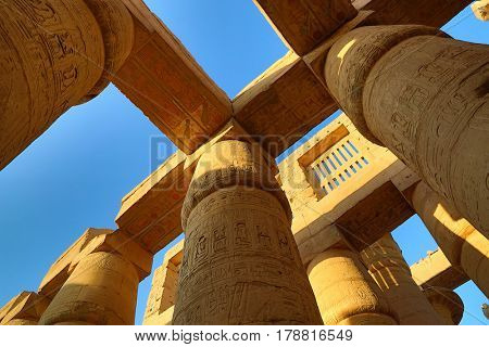 Columns in Karnak temple with ancient egypt hieroglyphics, Luxor