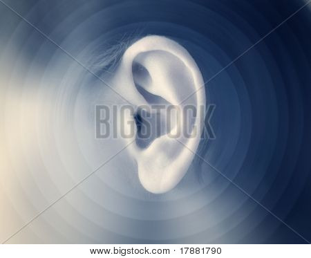 Man's ear with sound waves