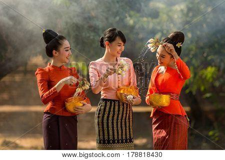 Laos girls splashing water durin tradition festival Songkran festival