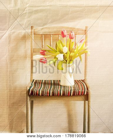 Tulips In Composition On The Chair