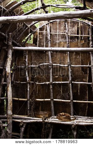 Plimoth Plantation, Plymouth, Massachusetts - September 10, 2014 - Vertical of the interior of a Wampanoag Indian hut made of branches and covered in vibrant bark in the Wampanoag Indian Village at Plimoth Plantation, Plymouth, Massachusetts