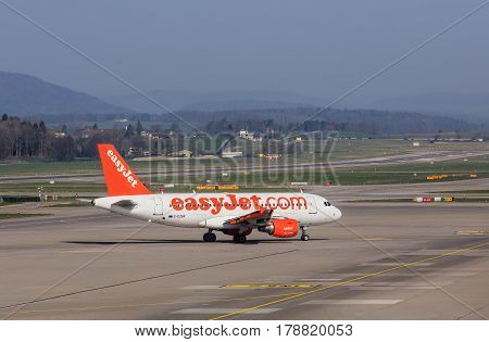 Kloten, Switzerland - 28 March, 2017: Airbus A319-111 of EasyJet taxiing in the Zurich airport. EasyJet (styled as easyJet) is a British airline, operating under the low-cost carrier model, based at London Luton Airport.