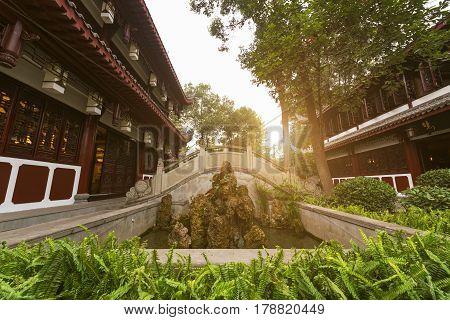 Traditional Garden And Stone Bridge In Wenshu Monastery