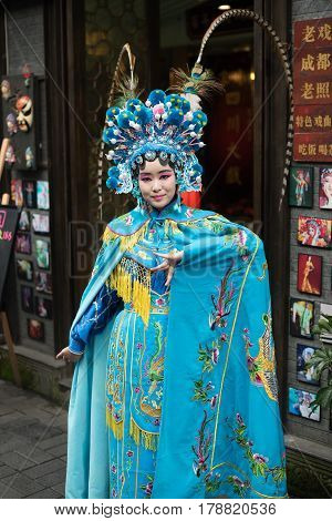 Chengdu Sichuan Province China - Dec 11 2015 : Portrait of a yound woman dressed in Sichuan Opera traditional costume in Kuan and Zhai alley touristic area.