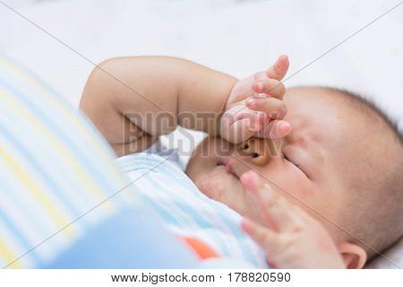Baby Rubbing It's Eyes,