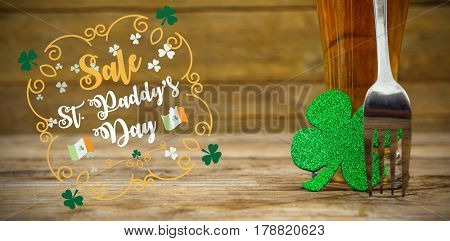Print against beer glass with fork and shamrock for st patricks day