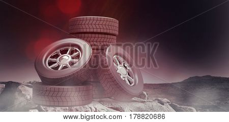 Row of tyres against mountain trail 3d