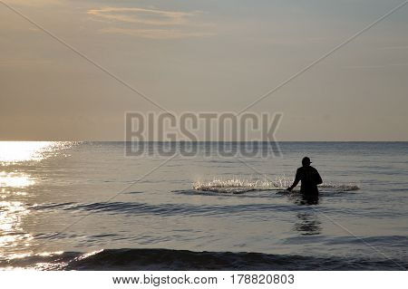 Fisherman is throwing the net in the sea